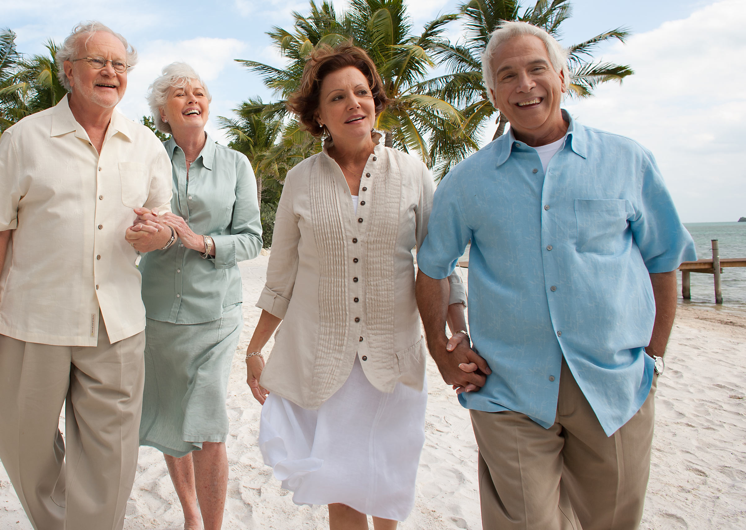 Seniors Walking on Beach